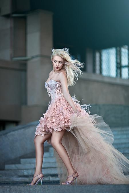 Blond beautiful luxurious woman in tan dress