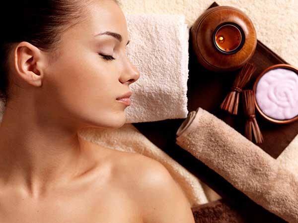 woman relaxing after facial